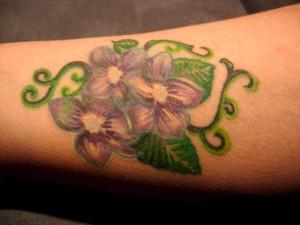 Mom's tattoo on right forearm